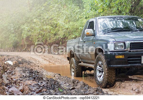 Off-road travel on mountain road, Adventure Travel, Rainy Season. - csp59412221