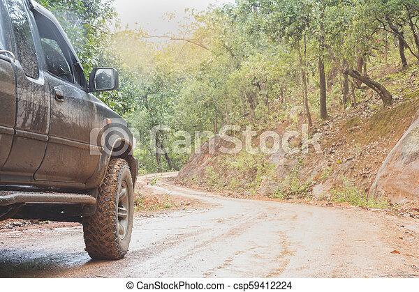 Off-road travel on mountain road, Adventure Travel, Rainy Season. - csp59412224
