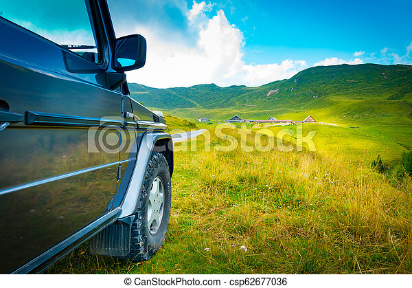 Off road vehicle on a mountain road - csp62677036