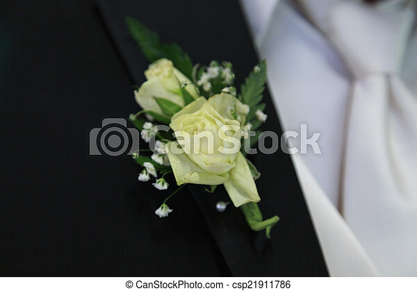 Off white boutonniere off white flowers of this grooms pictures off white boutonniere csp21911786 mightylinksfo Image collections