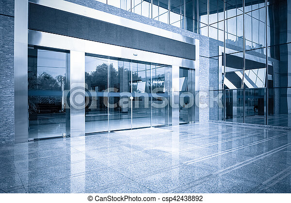 Office building entrance and automatic glass door modern stock office building entrance and automatic glass door csp42438892 planetlyrics Image collections