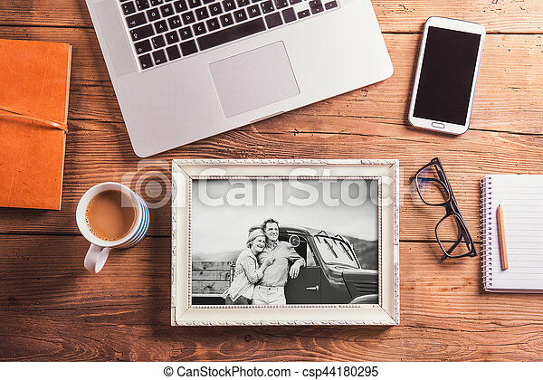 Office desk. Objects and black-and-white photo of senior couple - csp44180295