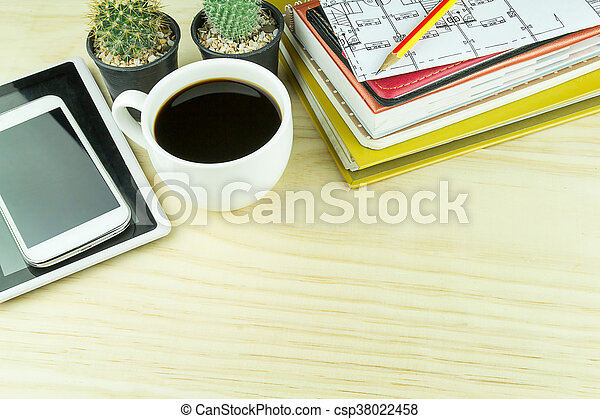 Office desk table with notebook, glasses, smart phone and a cactus - csp38022458