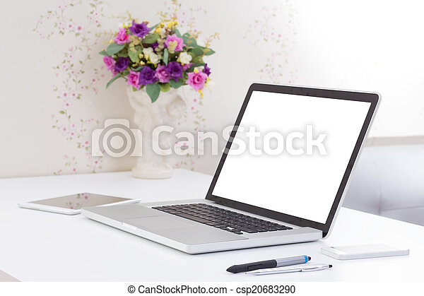 office desk with blank screen laptop computer - csp20683290