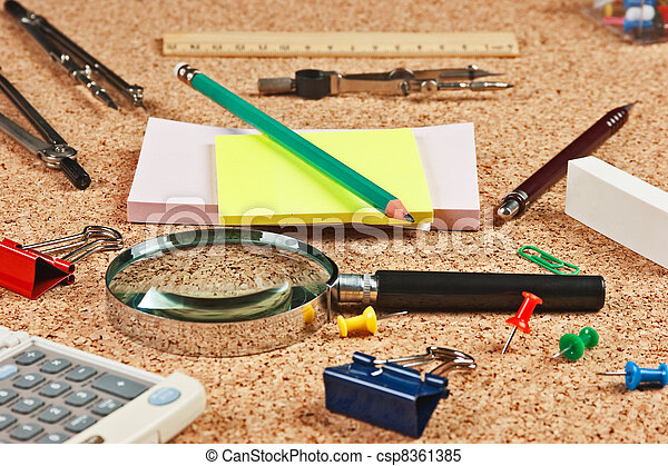 office supplies in a mess on the table - csp8361385