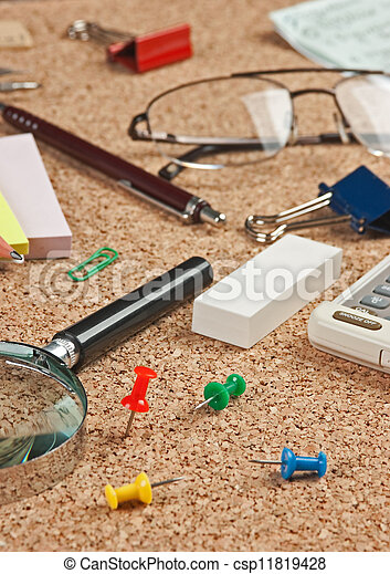 office supplies in a mess on the table - csp11819428