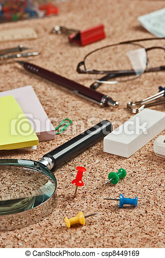 office supplies in a mess on the table - csp8449169