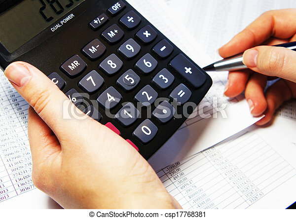 Office table with calculator, pen and accounting document   - csp17768381
