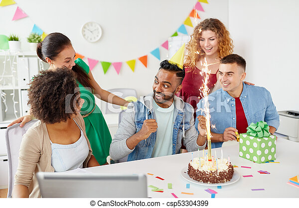 Office Team Greeting Colleague At Birthday Party