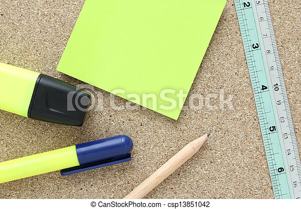 office tools on cork board - csp13851042