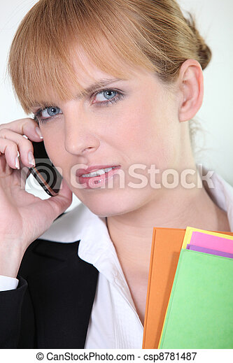 Office worker using a mobile phone - csp8781487