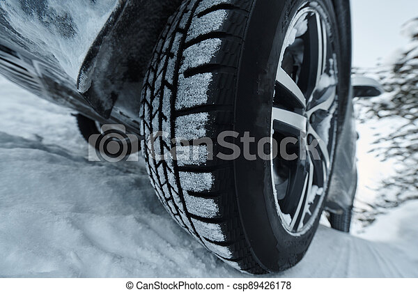 offroad suv car on icy winter north road - csp89426178