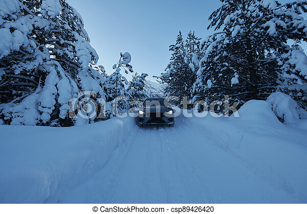 offroad suv car on icy winter north road - csp89426420