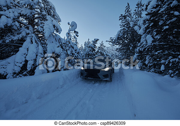 offroad suv car on icy winter north road - csp89426309