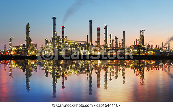 Oil and gas refinery at twilight with reflection - factory - petrochemical plant - csp15441107