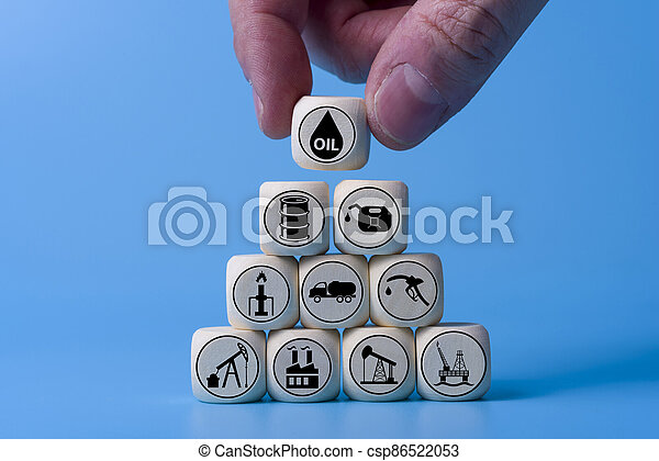 Oil concept with icons on wooden cubes, blue background. - csp86522053