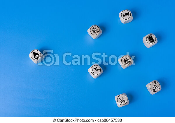 Oil concept with icons on wooden cubes, blue background. - csp86457530