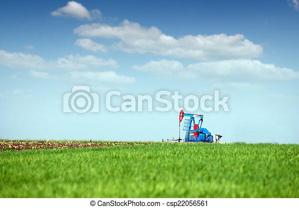 oil pump jack on green field - csp22056561