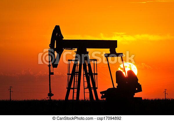 Oil Pump on orange sunset - csp17094892