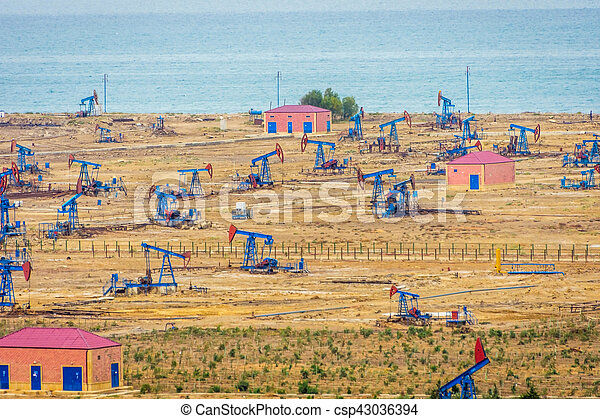 Oil pumps and rigs by the Caspian coast - csp43036394