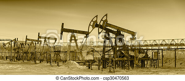 Oil pumps on a oil field. - csp30470563