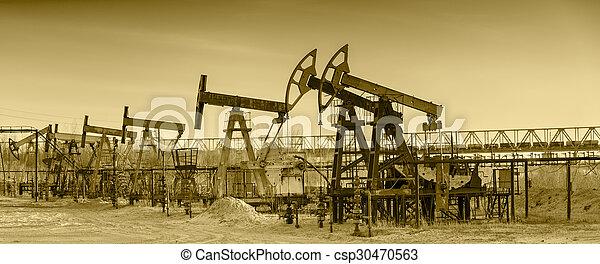Oil pumps on a oil field. - csp30470563