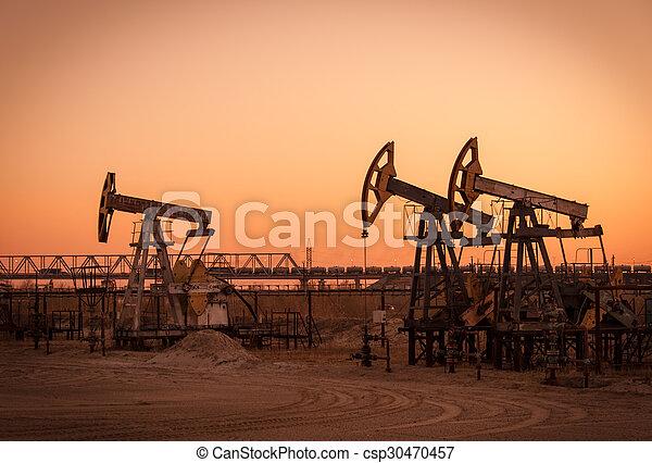 Oil pumps on a oil field. - csp30470457