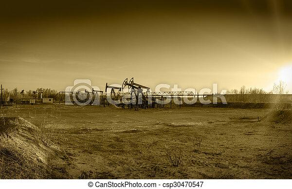 Oil pumps on a oil field. - csp30470547