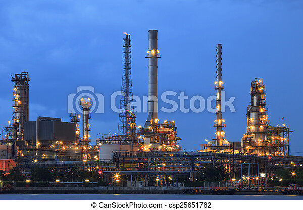 oil refinery plant in heavy industry estate against beautiful du - csp25651782