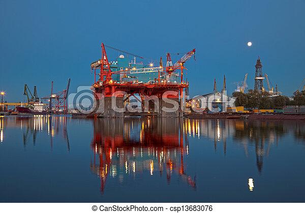 Oil rig at night - csp13683076