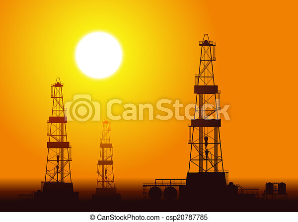 Oil rigs over sunset. - csp20787785