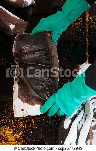 oil spill cleanup on working area. - csp25772949