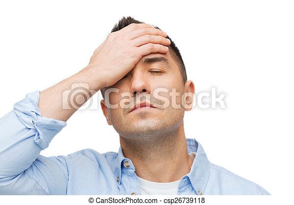 Un hombre infeliz con los ojos cerrados tocando su frente - csp26739118