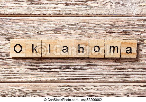 Oklahoma word written on wood block. Oklahoma text on table, concept - csp53299062