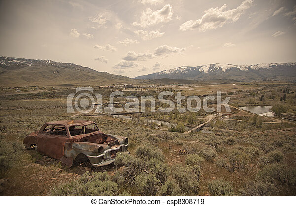 Old abandoned car with bullet holes - csp8308719