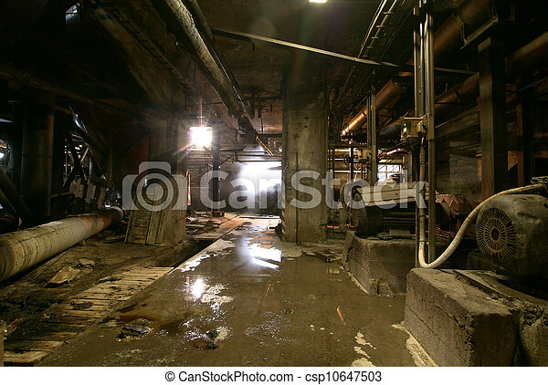 Old abandoned dirty empty scary factory interior - csp10647503
