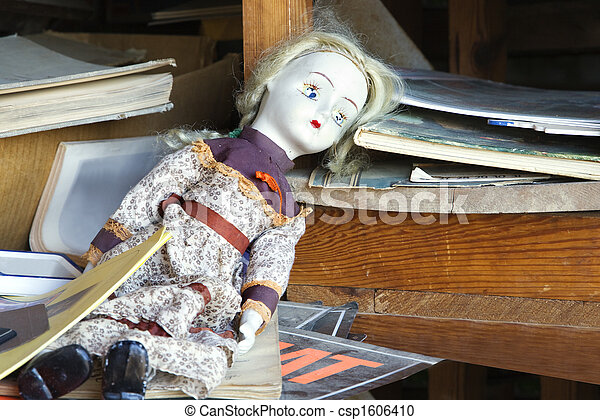 Old abandoned doll on shelf - csp1606410