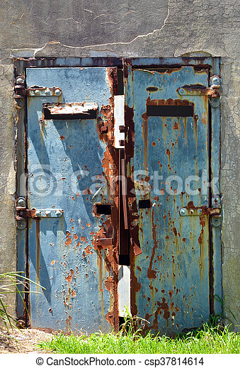 Old abandoned war bunker - csp37814614 & Old abandoned war bunker. Rusty blue doors of an old abandoned war ...