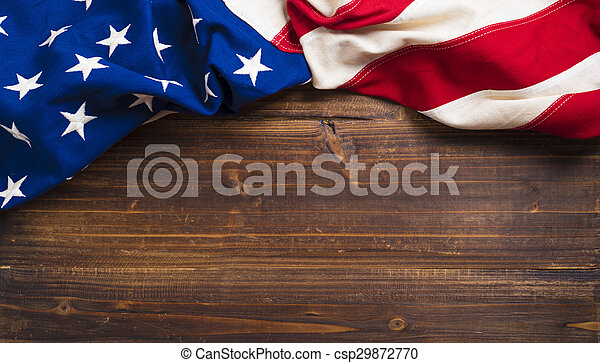 Old American Flag on wooden plank background - csp29872770