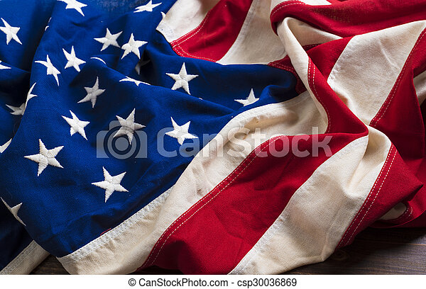 Old American Flag on wooden plank background - csp30036869