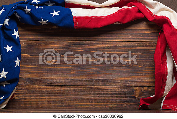 Old American Flag on wooden plank background - csp30036962