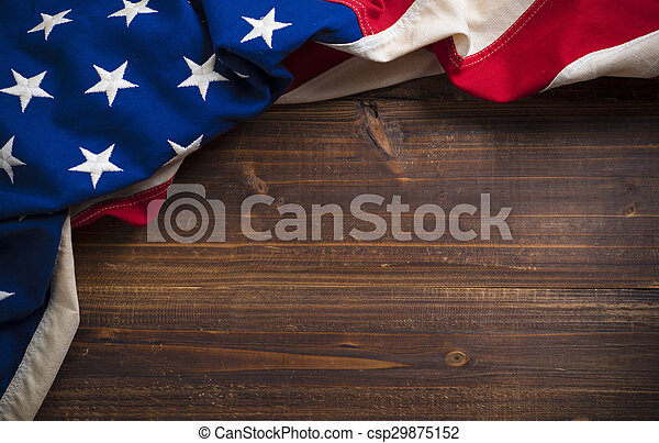 Old American Flag on wooden plank background - csp29875152