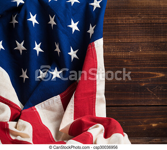 Old American Flag on wooden plank background - csp30036956