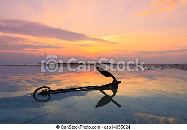 Old anchor in water at sunset - csp14055024