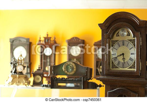 Old antique clocks - csp7450361
