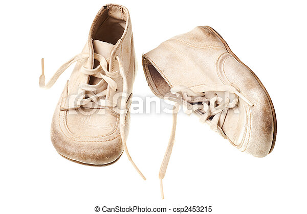 Old baby shoes isolated on white