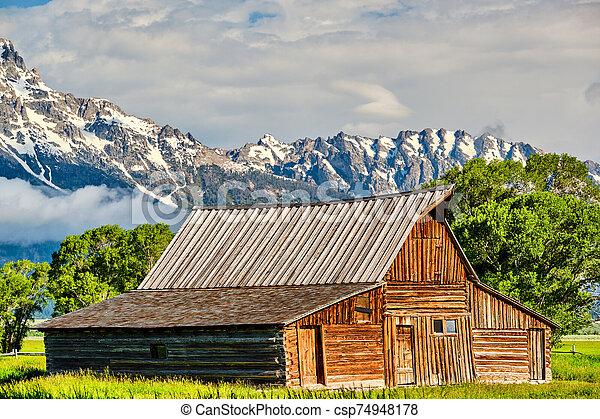 Old barn in Grand Teton Mountains - csp74948178