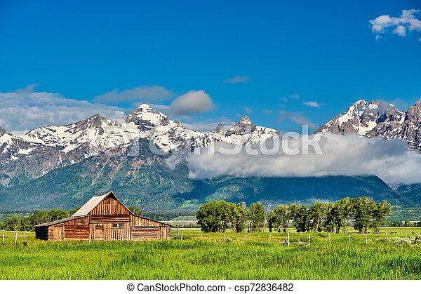 Old barn in Grand Teton Mountains - csp72836482
