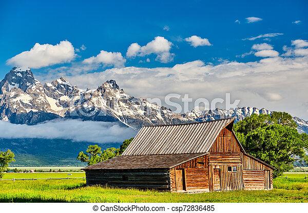Old barn in Grand Teton Mountains - csp72836485