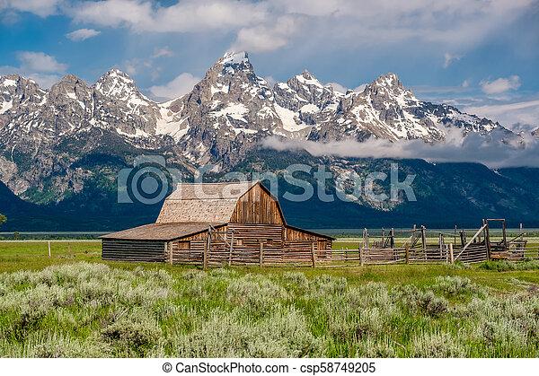 Old barn in Grand Teton Mountains - csp58749205